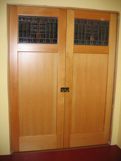 Double pocket door with custom stained glass panels