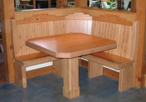 built-in corner bench and single pedestal table